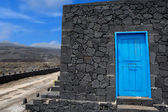 Blue door lava stone masonry wall at La Palma — Stock Photo