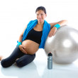 Beautiful pregnant woman at fitness gym relaxed — Stock Photo