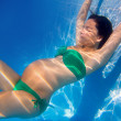 Beautiful pregnant woman underwater blue pool - 