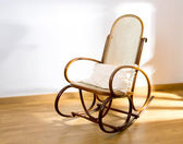 Golden retro rocker wooden swing chair on wood floor — Stock Photo
