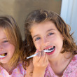 Blue eyes kids sister girl eating breakfast — Stock Photo #13829312