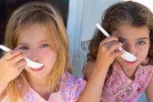 Blue eyes kids sister girl eating breakfast — Stock Photo