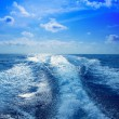 Boat wake prop wash foam in blue sky — Stock Photo #13830081