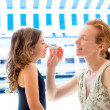 Children girl with mother applying sunscreen — Stock Photo #13830629