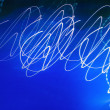 Abstract motion blurred lights on blue — Stock Photo #13832199