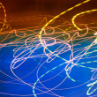 Abstract motion blurred lights on blue — Stock Photo #13832212