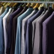 Colorful male suits in row in a hanger — Stok fotoğraf