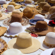 Hats display on a street market outdoor — Stok fotoğraf