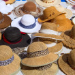Hats display on a street market outdoor - Stock Photo