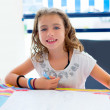 Children kid girl smiling with homework in summer - Stok fotoğraf