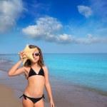 Blue beach girl with bikini starfish and sunglasses — Stock Photo #13833403