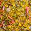 Spanish rice paella mixed of meat and seafood — Stock Photo #13834471