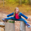 Open legs children girl or tree trunks at forest — Stock Photo