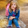 Blond kid girl pensive bored in the forest outdoor — Stock Photo #13839923