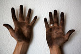 Black dirty man hands open palms on white — Stock Photo