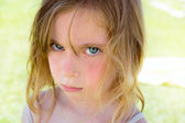 Angry blond children girl portrait looking camera — Stock Photo