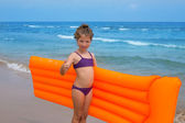Children kid girl playing in beach floating lounge — Stock Photo