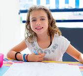 Children kid girl smiling with homework in summer — Stock Photo