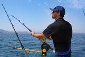 Blue sea fisherman in trolling boat with downrigger — Stok fotoğraf