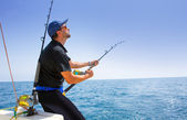 Blue sea offshore fishing boat with fisherman — Stok fotoğraf