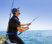 Blue sea offshore fishing boat with fisherman — Stock Photo
