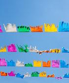 Colorful tissue Paper fringe garland under blue sky — Stock Photo