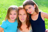 mother and two sister daughters in the garden — Stock Photo