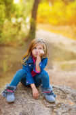 Blond kid girl pensive bored in the forest outdoor — Stock Photo