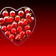 Christmas baubles heart shape in red and gold — Stock Photo