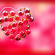 Christmas baubles heart shape in red and gold — Stok fotoğraf
