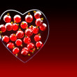 Christmas baubles heart shape in red and gold - Stock Photo