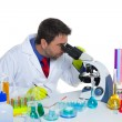 Chemical laboratory scientist man looking microscope - Foto de Stock
