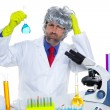 Crazy nerd scientist silly man on chemical laboratory - Stock Photo
