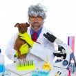 Crazy nerd scientist silly veterinary man with dog at lab — Стоковая фотография