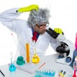 Crazy mad nerd scientist at laboratory microscope - Foto de Stock