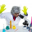 Crazy mad nerd scientist at laboratory microscope — Stock Photo
