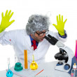 Stock Photo: Crazy mad nerd scientist at laboratory microscope