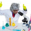 Crazy mad nerd scientist at laboratory microscope - Foto Stock