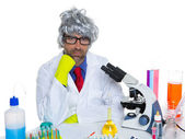 Carzy pensive nerd scientist at chemical laboratory — Stock Photo