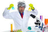 Crazy nerd scientist silly man on chemical laboratory — Stock Photo