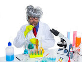 Crazy silly nerd scientist drinking chemical experiment — Stock Photo