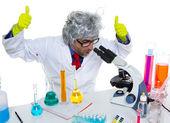 Crazy mad nerd scientist at laboratory microscope — Stock Photo