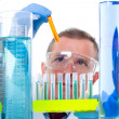 Laboratory scientist working at lab with test tubes - Foto de Stock