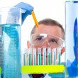 Laboratory scientist working at lab with test tubes - Foto Stock