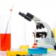 Chemical laboratory with microscope test tube flask — Stock Photo #16087821