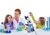 Children girlas and teacher woman at school laboratory — Stock Photo