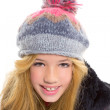 Kid girl with winter wool cap smiling on white — Stock Photo