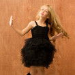 Black dress kid girl dancing and twisting vintage — Stock Photo #16094785