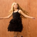 Black dress kid girl dancing and twisting vintage — Stock Photo