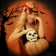 Halloween kid girl with pumpkin and skull smiling - Stockfoto